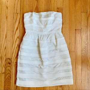 J. Crew cream dress with embroidery detail.